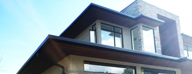 Black aluminum gutters and cedar soffits