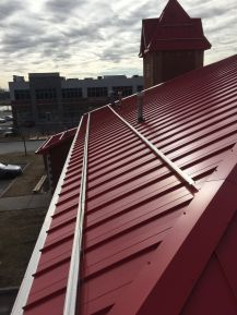 Metal roof with snow stoppers