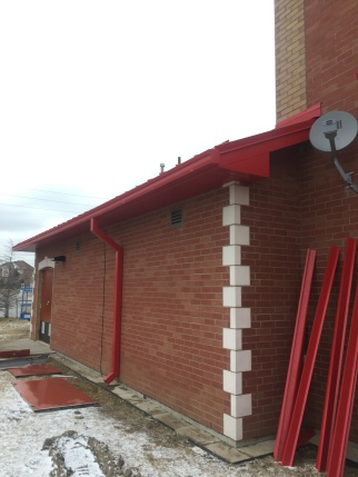 Custom gutters with downspouts