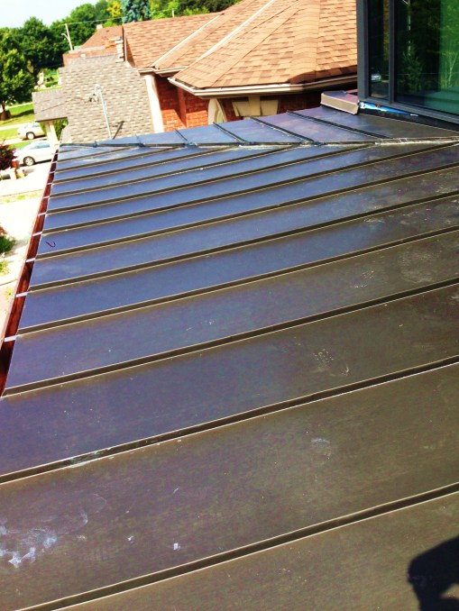 Low slope standing seam roof